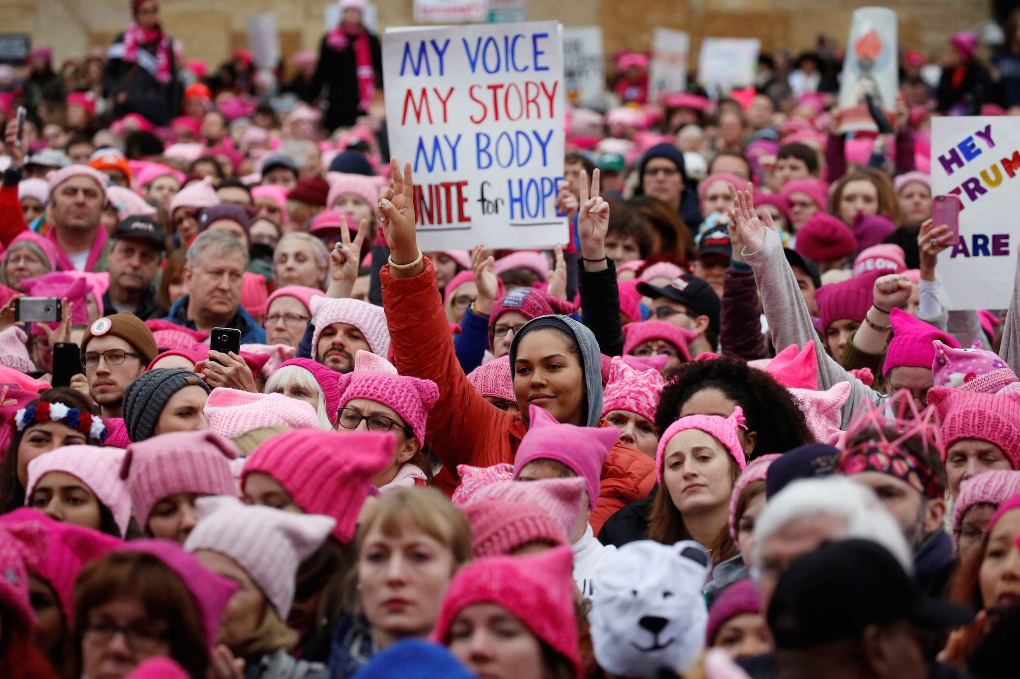 Women's March crowd wearing pink hats