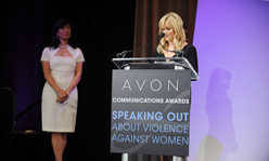 Reese Witherspoon at podium with Andrea Jung