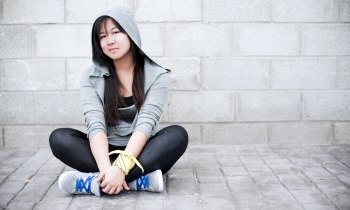 Teen sitting_Featured Image