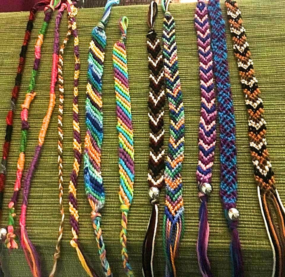 several colorful bracelets displayed on table