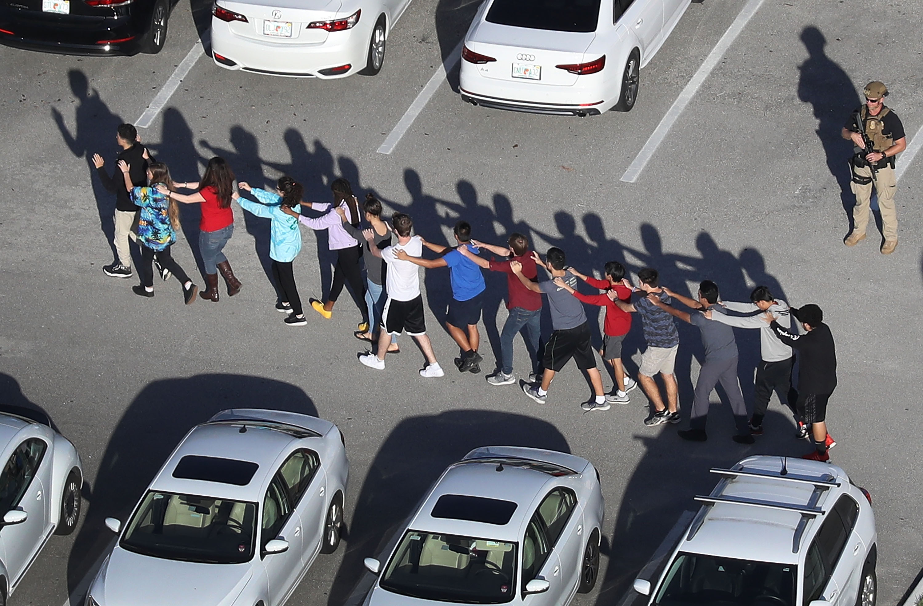 students evacuating at parkland high school after shooting
