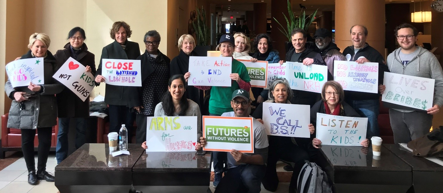 FUTURES board members, staff and friends show off their posters before the March for Our Lives.