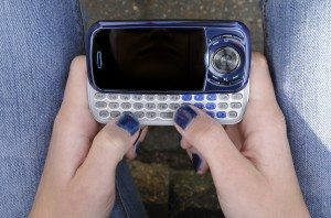 teen girl hands nailpolish cellphone
