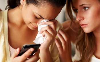 teen girls crying cellphone
